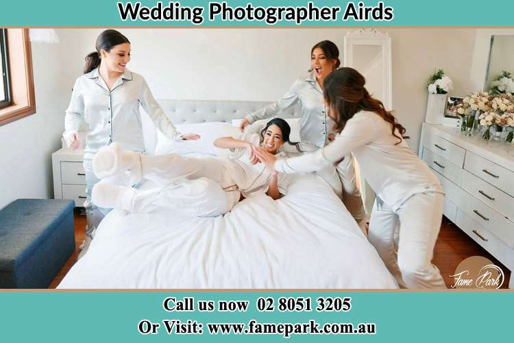 Photo of the Bride and the bridesmaids playing on bed Airds NSW 2560