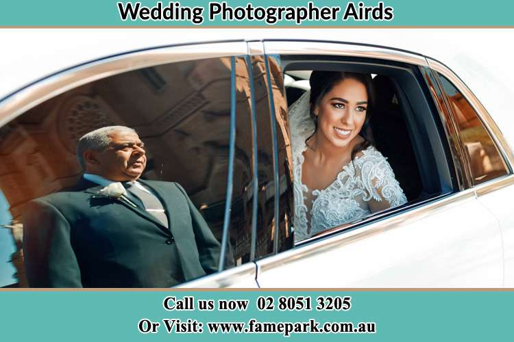 Photo of the Bride inside the bridal car with her father standing outside Airds NSW 2560