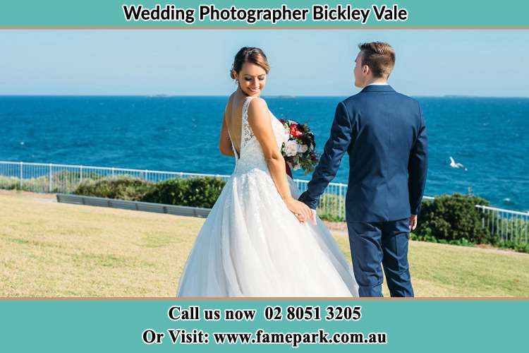 Photo of the Bride and the Groom holding hands at the yard Bickley Vale NSW 2570