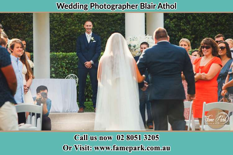 Photo of the Bride with her father walking the aisle Blair Athol NSW 2560