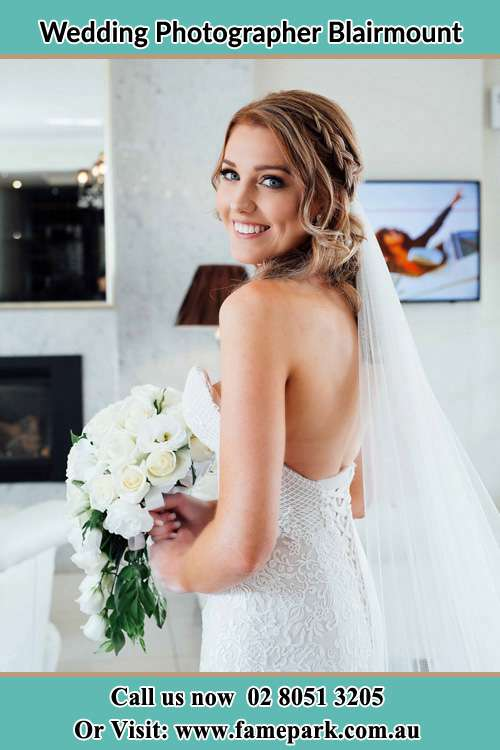 Photo of the Bride holding flower bouquet Blairmount NSW 2559