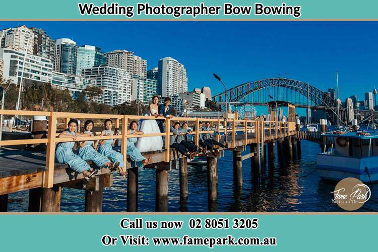 Photo of the Groom and the Bride with the entourage at the bridge Bow Bowing NSW 2556
