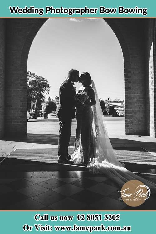 Photo of the Groom and the Bride kissing at the front of the church Bow Bowing NSW 2556