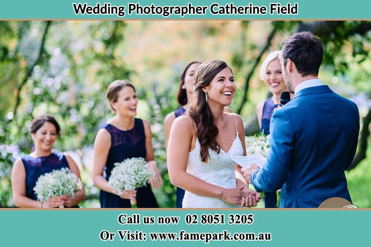 Photo of the Groom bringing flower to the Bride Catherine Field NSW 2557