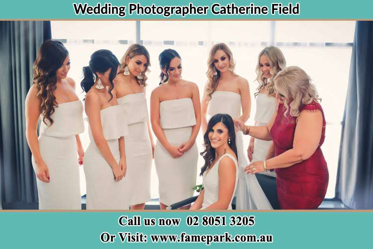Photo of the Bride and the secondary sponsor preparing Catherine Field NSW 2557