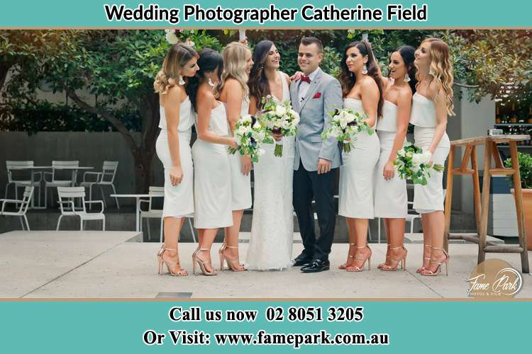 Photo of the Bride and the Groom with the bridesmaids Catherine Field NSW 2557