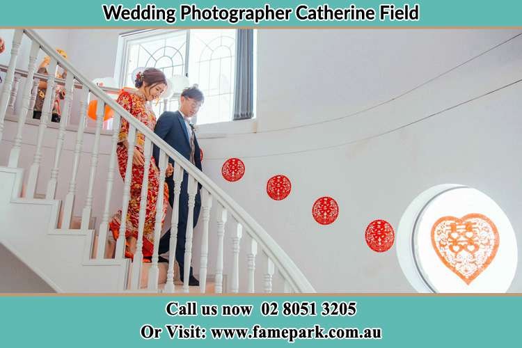 Photo of the Bride and the Groom going down the stair Catherine Field NSW 2557