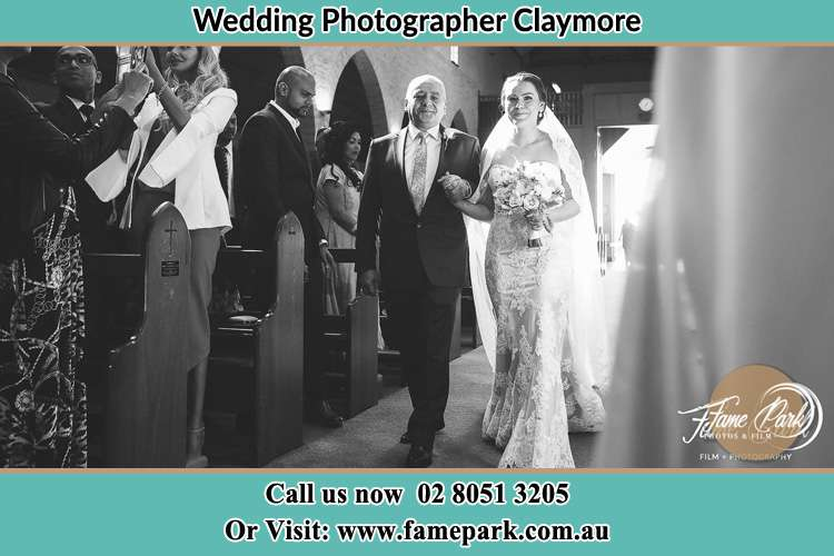 Photo of the Bride with her father walking the aisle Claymore NSW 2559
