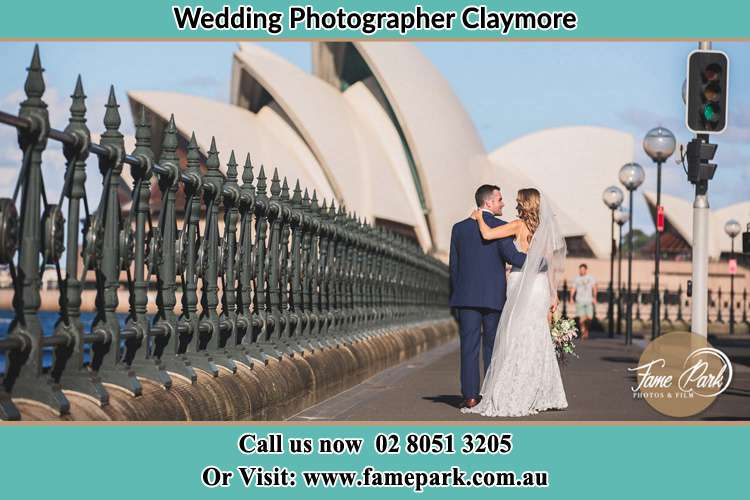The Groom and the Bride walking towards the Sydney Grand Opera House Claymore NSW 2559