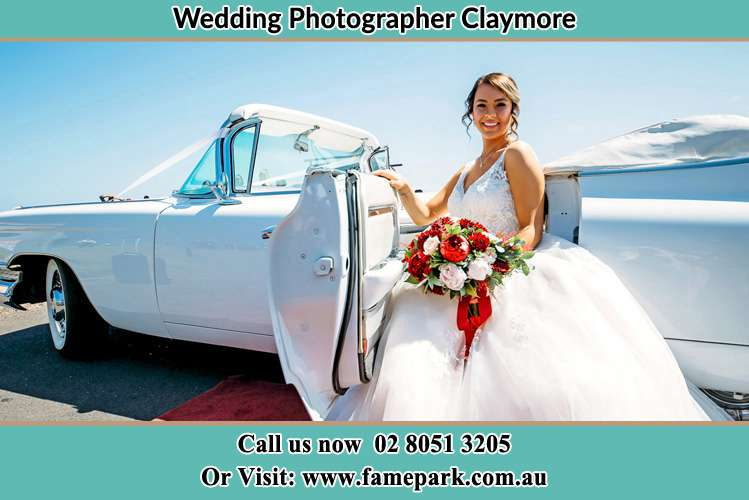 Photo of the Bride outside the bridal car Claymore NSW 2559