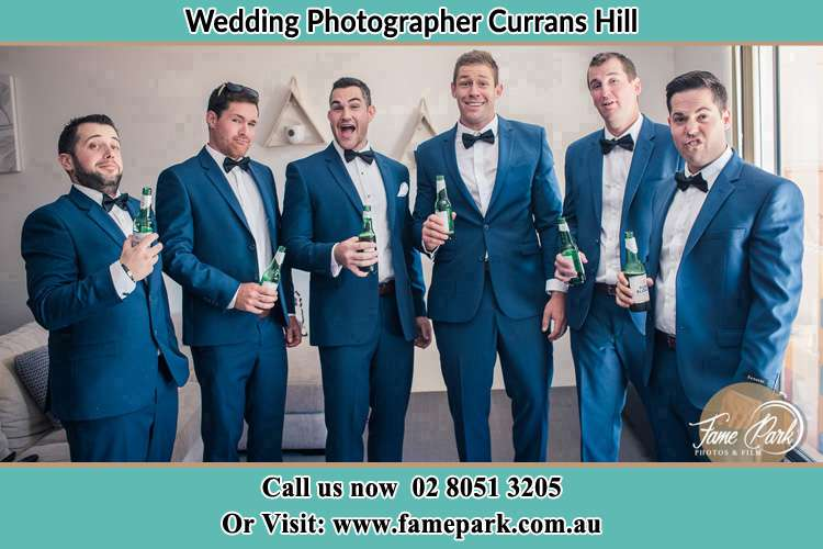 The groom and his groomsmen striking a wacky pose in front of the camera Currans Hill NSW 2567