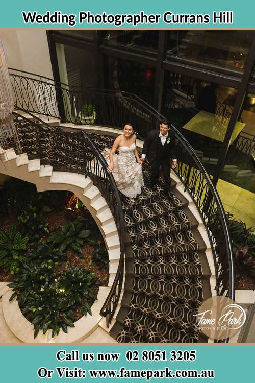 Photo of the Bride and the Groom going down the stair Currans Hill NSW 2567