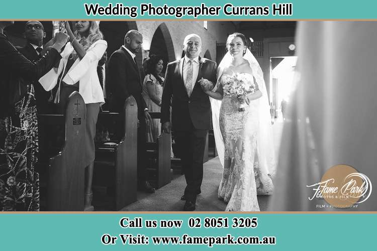 Photo of the Bride with her father walking the aisle Currans Hill NSW 2567