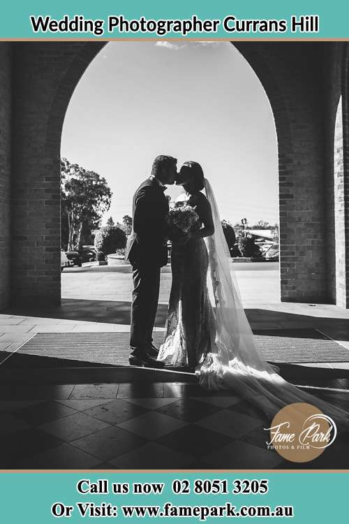 Photo of the Groom and the Bride kissing Currans Hill NSW 2567