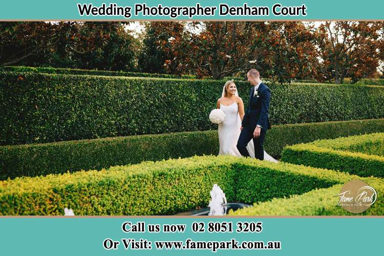 Photo of the Bride and the Groom walking at the garden Denham Court NSW 2565