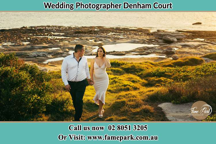 Photo of the Groom and the Bride walking near the lake Denham Court NSW 2565