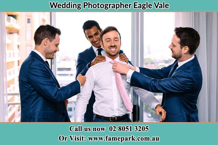 Photo of the Groom helping by the groomsmen getting ready Eagle Vale NSW 2558
