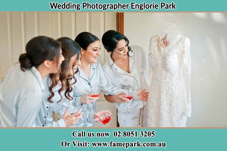 Photo of the Bride and the bridesmaids looking at the wedding gown Englorie Park NSW 2560