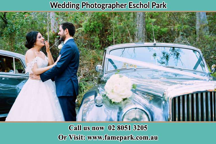 Photo of the Bride and the Groom near the bridal car Eschol Park NSW 2558