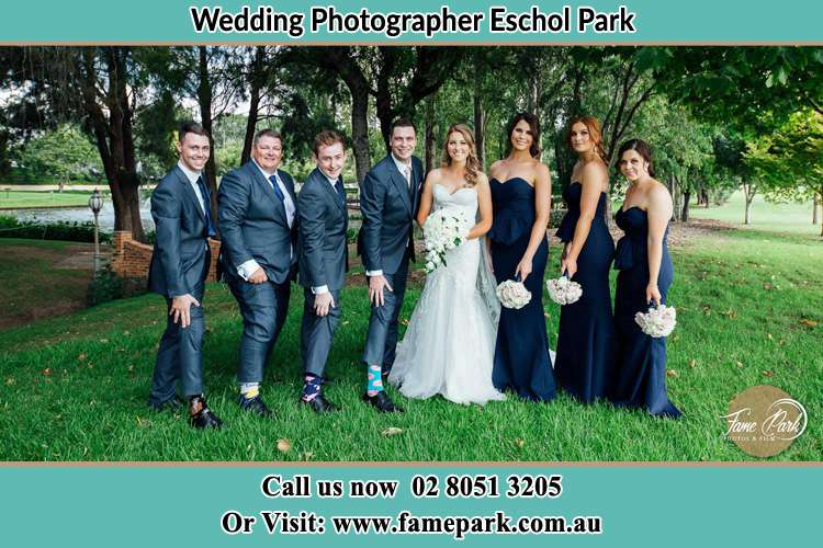 The Bride and the Groom with their entourage pose for the camera Eschol Park NSW 2558