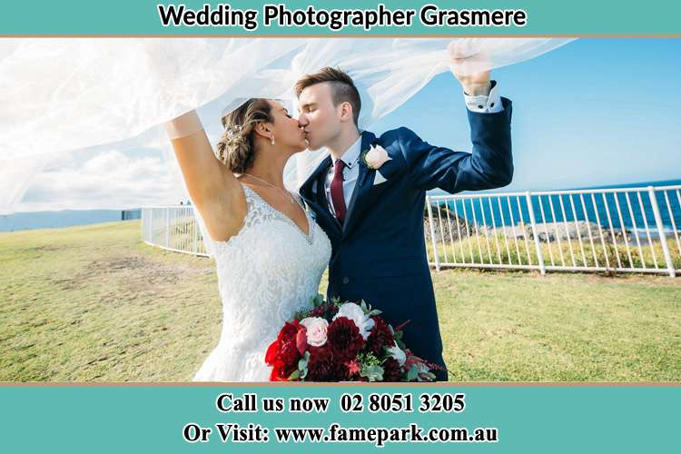 Photo of the Groom and the Bride kissing at the yard Grasmere NSW 2570