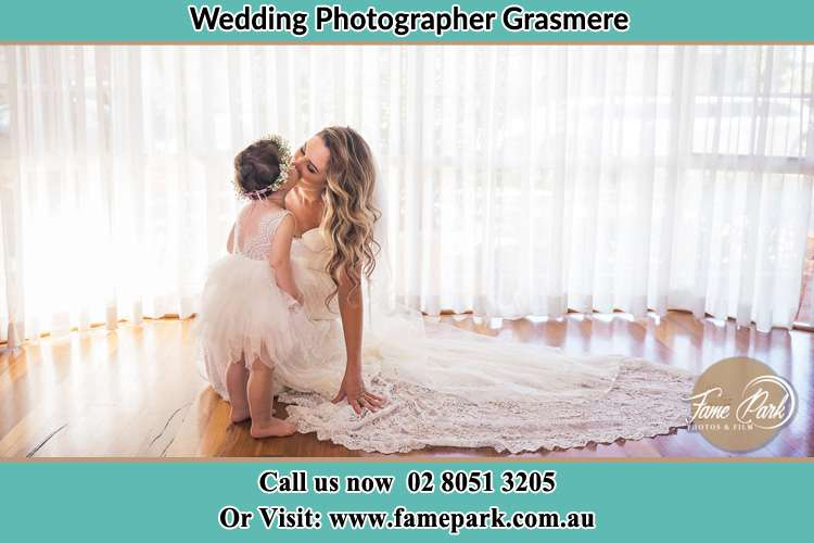 Photo of the Bride kiss the flower girl Grasmere NSW 2570