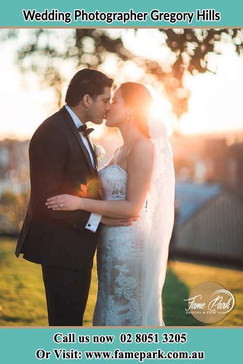 Photo of the Groom and the Bride kissing at the yard Gregory Hills NSW 2557