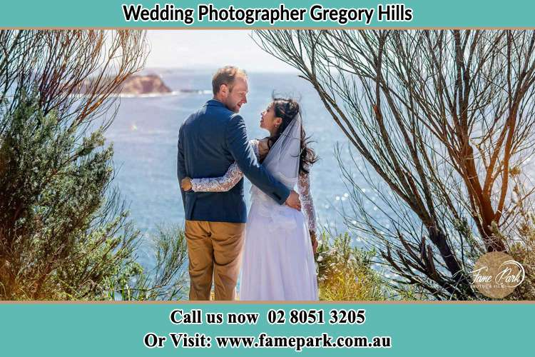 Photo of the Groom and the Bride looking each other near the sea front Gregory Hills NSW 2557