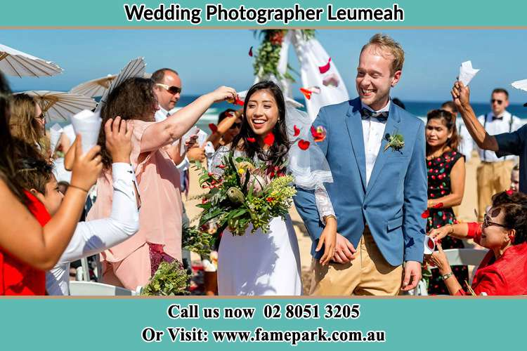 Photo of the Bride and the Groom showering flower petal by the visitors Leumeah NSW 2560