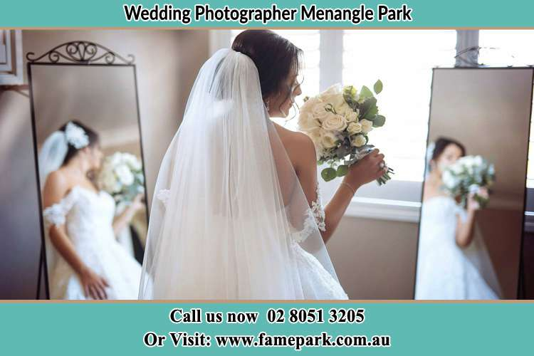Photo of the Bride holding flower at the front of the mirrors Menangle Park NSW 2563
