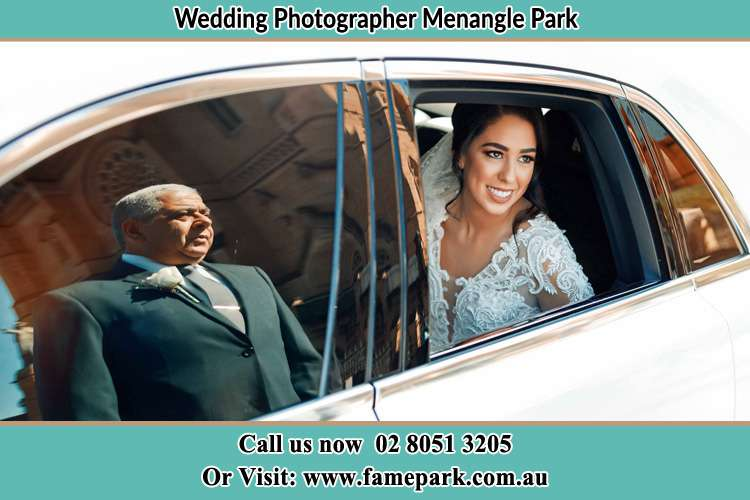 Photo of the Bride inside the bridal car with her father standing outside Menangle Park NSW 2563