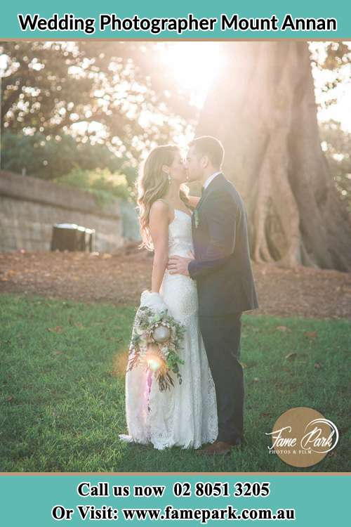 Photo of the Bride and the Groom kissing at the yard Mount Annan NSW 2567