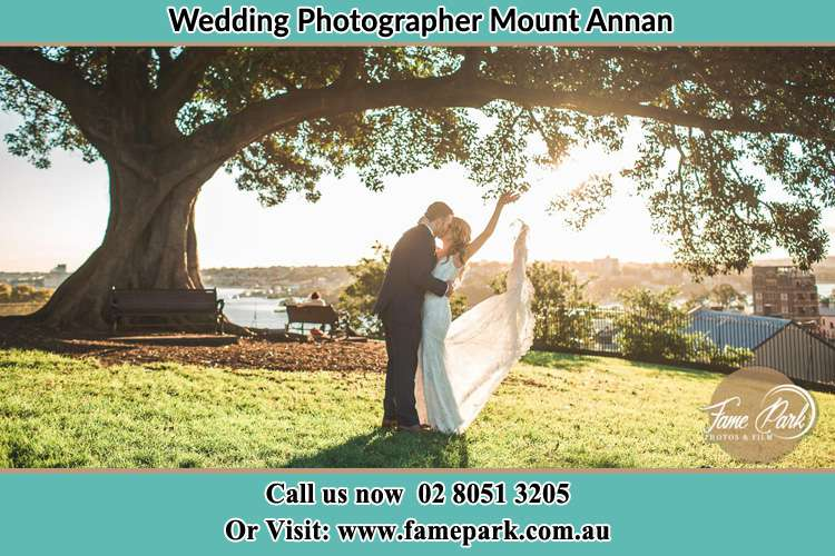 Photo of the Bride and the Groom kissing under the tree Mount Annan NSW 2567