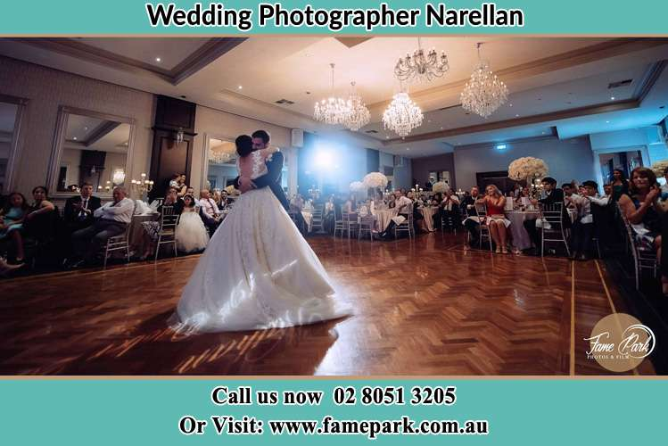 Photo of the Bride and the Groom hugging on the dance floor Narellan NSW 2567