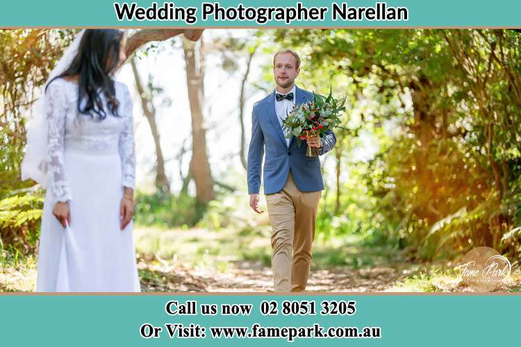 Photo of the Groom bringing flower to the Bride Narellan NSW 2567