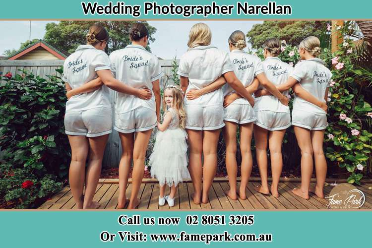 Behind photo of the Bride and the bridesmaids with the flower girl looking back Narellan NSW 2567
