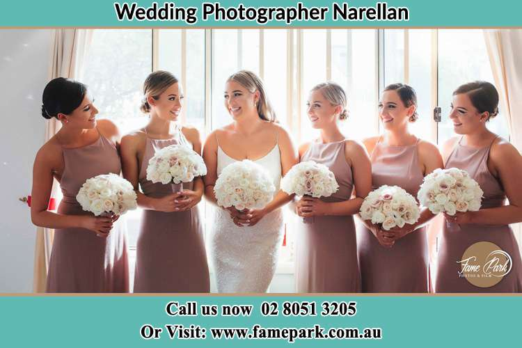 Photo of the Bride and the bridesmaids holding flower bouquet Narellan NSW 2567