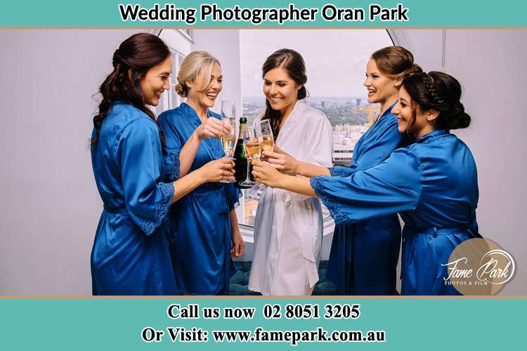 Photo of the Bride and the bridesmaids drinking wine Oran Park NSW 2570