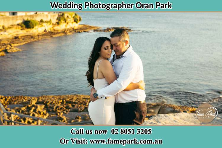 Photo of the Bride and the Groom hugging near the lake Oran Park NSW 2570