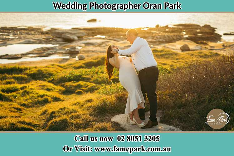 Photo of the Bride and the Groom dancing near the lake Oran Park NSW 2570