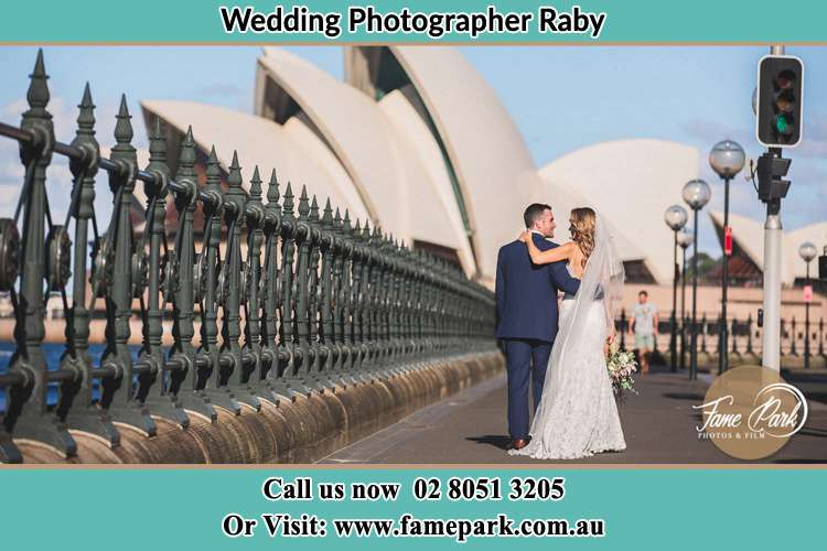 The Groom and the Bride walking towards the Sydney Grand Opera House Raby NSW 2566