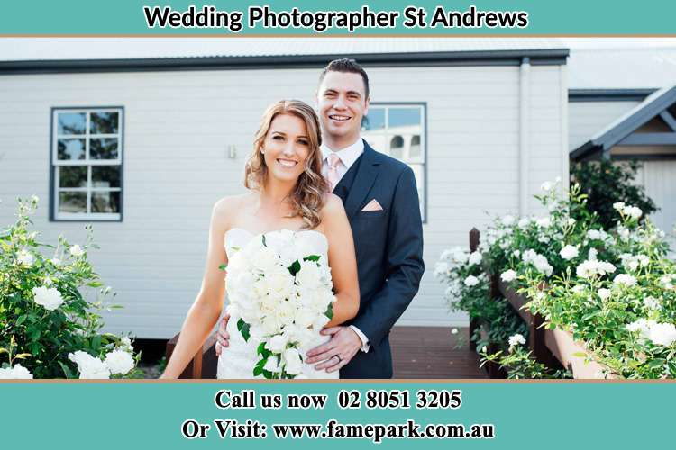 Photo of the Bride and the Groom at the front house St Andrews NSW 2566