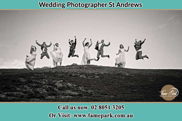 Jump shot photo of the Groom and the Bride with the entourage St Andrews NSW 2566