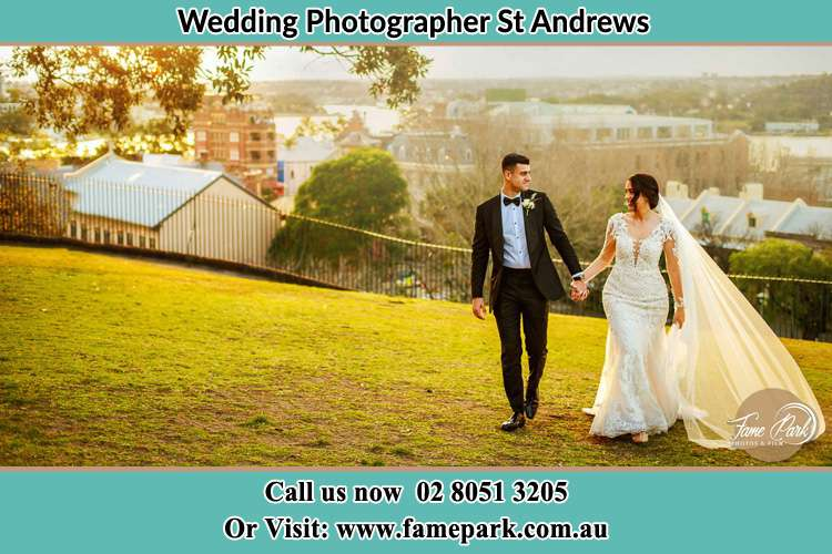 Photo of the Groom and the Bride walking at the yard St Andrews NSW 2566