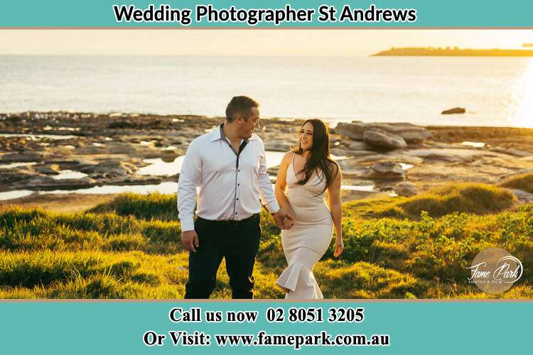 Photo of the Groom and the Bride walking near the lake St Andrews NSW 2566