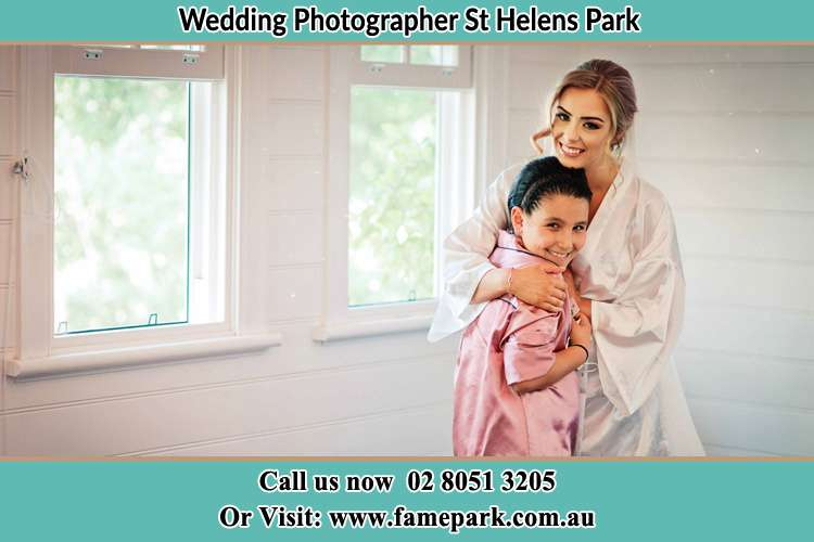Photo of the Bride hugging the flower girl St Helens Park NSW 2560
