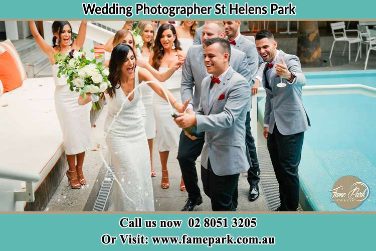 Photo of the Groom and the Bride celebrating with the secondary sponsors St Helens Park NSW 2560