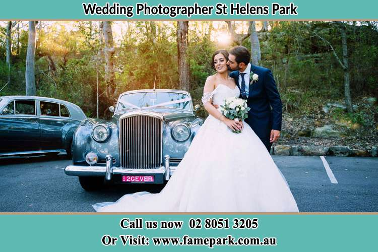 Photo of the Bride and the Groom at the front of the bridal car St Helens Park NSW 2560